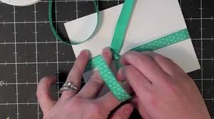 patterned ribbon tying a bow with patterned ribbon