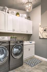 White Cabinets For Laundry Room Simple Laundry Room With White Cabinets Grey Washer Dryer And
