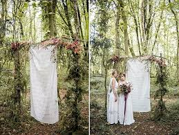 wedding arches made of branches boho chic feast in the woods wedding shoot weddingomania