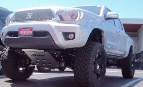 white lifted toyota tacoma stage 2 pro comp lift toyo tires