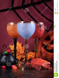 happy halloween ghoulish party cocktail drinks with color goblets