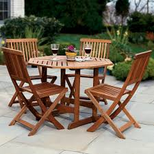 Patio Furniture York Pa by The Trestle Patio Table And Stow Away Chairs Hammacher Schlemmer