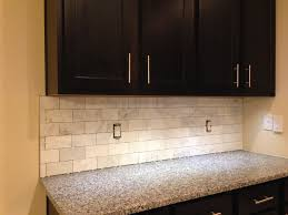 backsplash edge of cabinet or countertop schluter trim on a mable tile incomplete needs grout clean edge