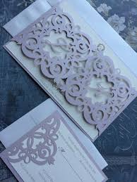 folding wedding invitations laser cut wedding invitation monogram iron gate bi
