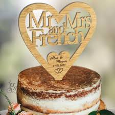 heart wedding cake toppers personalised wooden heart wedding cake topper laser cut with surname