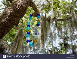 oak tree in new orleans city park with murano glass rendition of