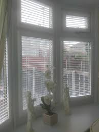 perfect fit wooden blinds in a bay window visionary blinds
