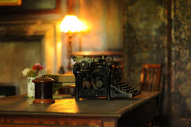 old fashioned office secretary desk old typewriter lamp in