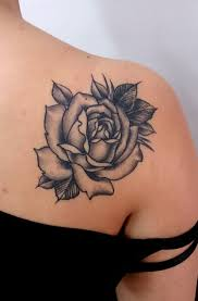 healed traditional rose in black and grey by carlos tattoo