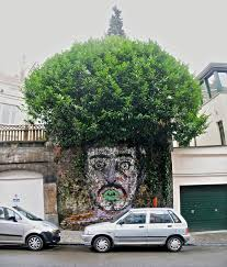 with human heads paintings surrounded by tree