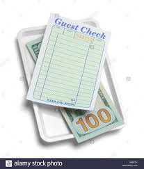 guest check tray receipt tray with money and blank guest check isolated on white