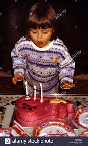 birthday cake 3 year old blowing out candles stock photo