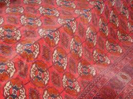 bukhara tappeto bukhara russo 290 203 disegno tekke su classico rosso di fondo