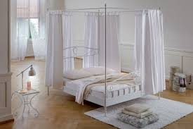 wrought iron four poster canopy bed frame combined white fitted
