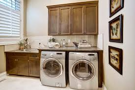 table top washer dryer washer dryer pedestal laundry room traditional with brown countertop