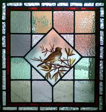 antique victorian hand painted bird in stained glass window