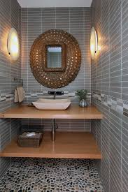 large multi toned pebbles set the tone for this powder bathroom