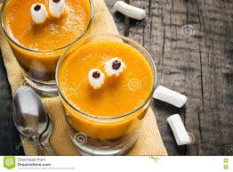 Layered Dessert Halloween Pumpkin Smoothie Decorated With Eyes