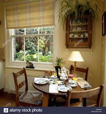small dining rooms checked neutral blind on window in small dining room with pine