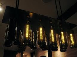 Wine Bottle Light Fixtures 25 Unique Wine Bottle Chandelier Ideas On Pinterest Recycled