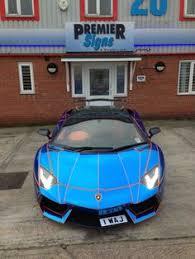 chrome blue lamborghini aventador blue chrome style wrap by premier signs to orange oakley