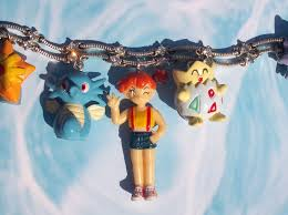 misty and her pokemon charm bracelet with horsea goldeen staryu