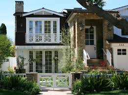 gorgeous ranch house curb appeal with white wooden door with glass