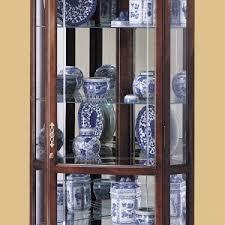 Ideas Design For Lighted Curio Cabinet Decorating Attractive Corner Curio Cabinet For Interior Furniture