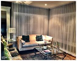 ripplefold drapes from ceiling to floor make the room look taller
