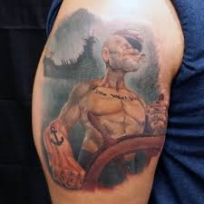 funny looking old cartoon like sailor popeye tattoo with big