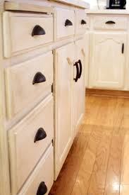 How To Update Kitchen Cabinet Doors by How To Revive Old Cabinets How To Restain Cabinets Darker How To
