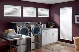 decorating purple wall with glass window and faux wood blinds