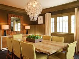 dining room wall mirrors chandelier hung in the ceiling over dining table and chairs in the