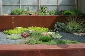 sheet metal fence landscape contemporary with border plantings
