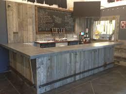 hand crafted reclaimed wood tasting room wall cladding caulk