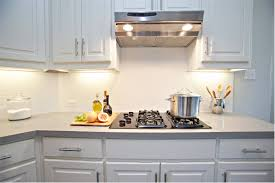 tiles backsplash light granite with cabinets paint grade