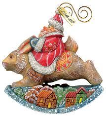 painted santa on rabbit figurine ornament traditional