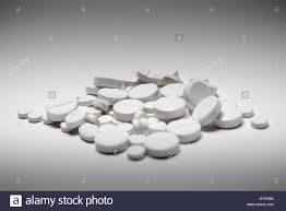 haphazard a haphazard pile of mixed white pills of varying sizes and shapes