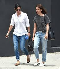 courteney cox is casually chic in crisp white blouse and blue
