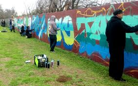 wall in fresno park a canvas for graffiti artists tribute the a crew of graffiti artists called lords paint a quarter mile long wall to