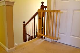 baby gates for stairs with round banisters decoration