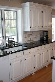 kitchen grey cabinets cream backsplash light granite countertops