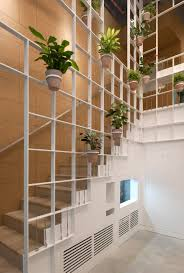 pot plants cover trellis like walls inside london cafe by