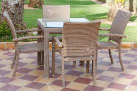 Outdoor Patio Furniture Cane Outdoor Patio Furniture With Glass Table And Chairs On Tiled