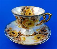 roses teacups pretty pedestal with yellow roses luster japan tea cup and saucer