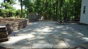 Paver Patio With Retaining Wall by Build A Patio On A Hillside Devine Escapes