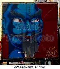 evil wizard drawing on blue wall reflections in the water stock