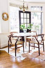 cowhide rug under kitchen table home table decoration