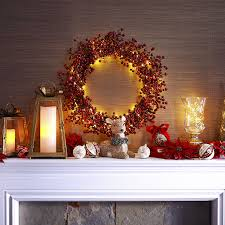 a glitter faux berry wreath highlighted with some pier 1 glimmer