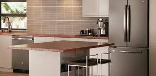 white kitchen cabinets with black slate appliances slate appliances